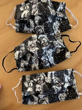 cloth facemask with old english sheepdogs printed on them